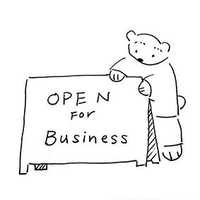 Pu-kunn holding a open sign